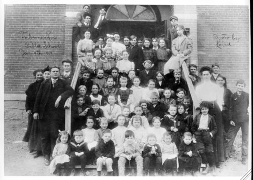 Students and teachers pose outside the Tribune school, Tribune, Greeley County, Kansas - Page