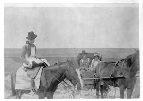 A woman rides side saddle on a horse, Greeley County, Kansas - Page