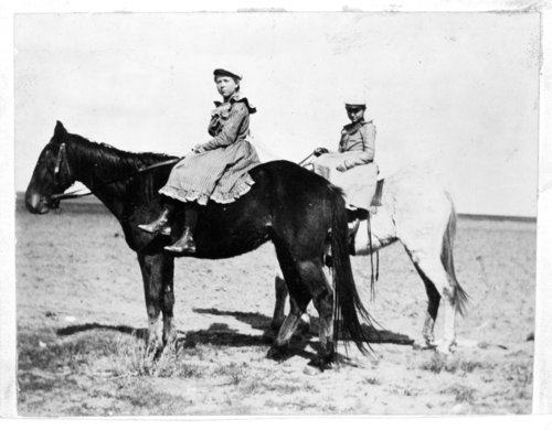 Two girls riding horses side saddle, Greeley County, Kansas - Page