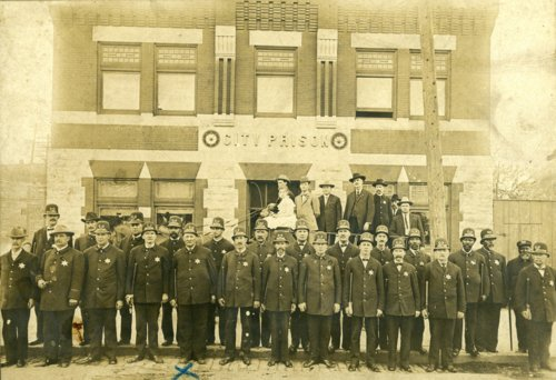 Police officers posed in front of the jail in Topeka, Kansas - Page