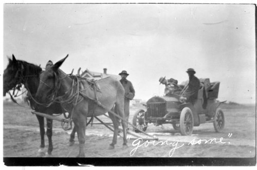 Mule team pulling broken down automobile, Tribune, Greeley County, Kansas - Page