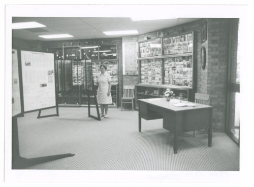 Margaret Pile stands in the Greeley County History Room in the new courthouse, Tribune, Greeley County, Kansas - Page
