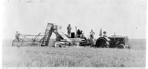 Early combine and header in a field in Greeley County, Kansas - Page