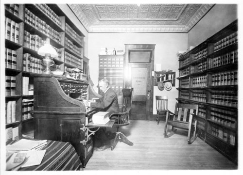 D.R. Beckstrom at his desk in his law office, Tribune, Greeley County, Kansas - Page