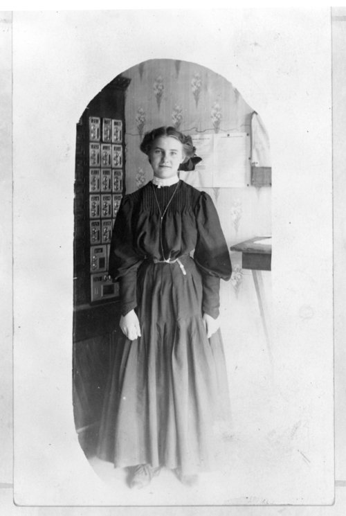 Female post office employee, Tribune, Greeley County, Kansas, about 1914 - Page