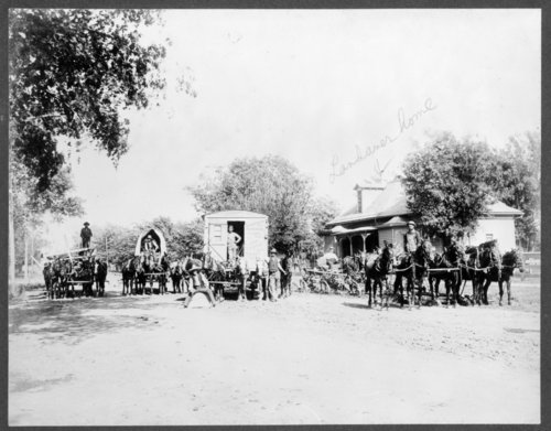 Labor crew in front of the Landauer residence in Larned, Kansas - Page