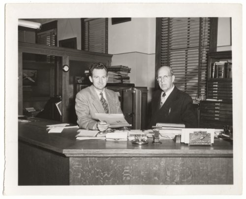 Harry Turbet Taylor and Ralph Taylor in the Taylor Abstract Title Company office in Larned, Kansas - Page