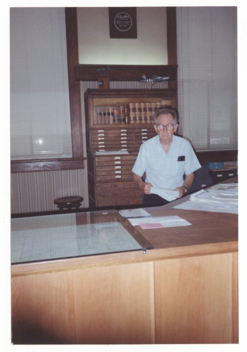 Harry Turbet Taylor in the Taylor Abstract Title Company office in Larned, Kansas - Page