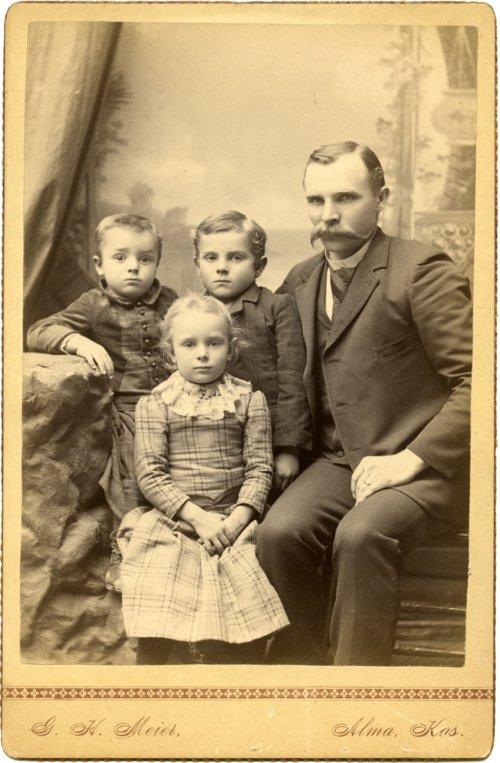 Studio portrait of Louis Palenske and children - Page