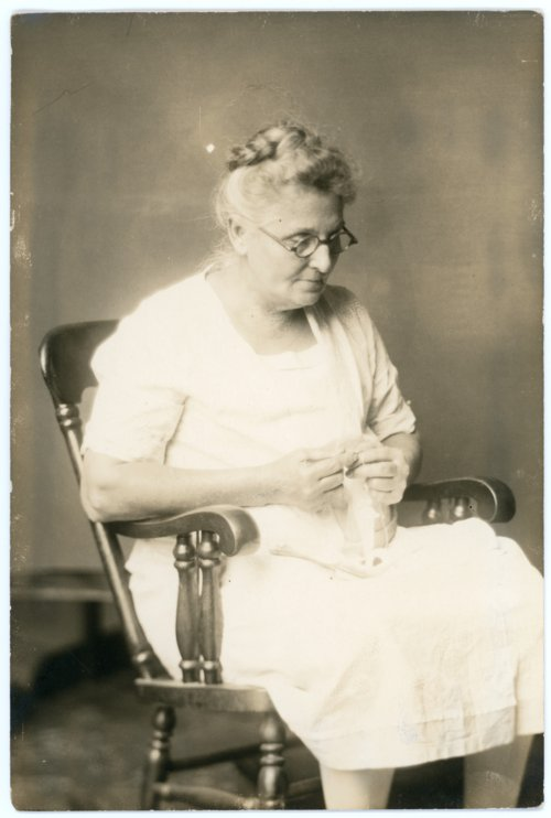 Emma Palenske seated in rocking chair - Page
