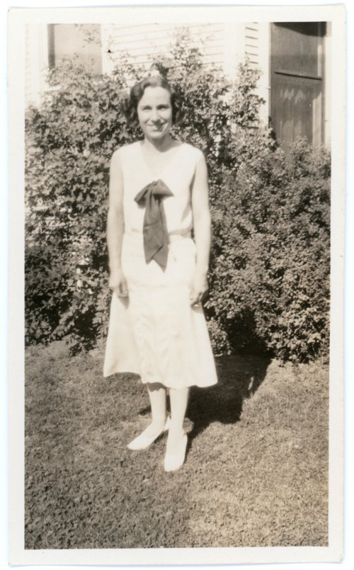 Florence Palenske standing in yard - Page
