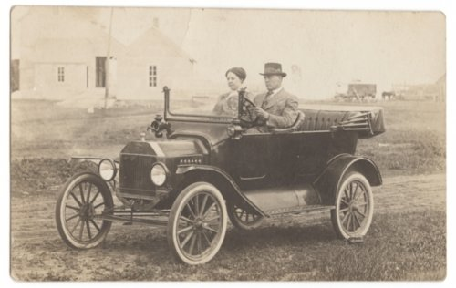 Jessie Norris and an unidentified man in a car - Page