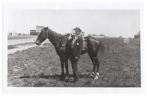 Man posing with horse, Wallace, Wallace County, Kansas - Page
