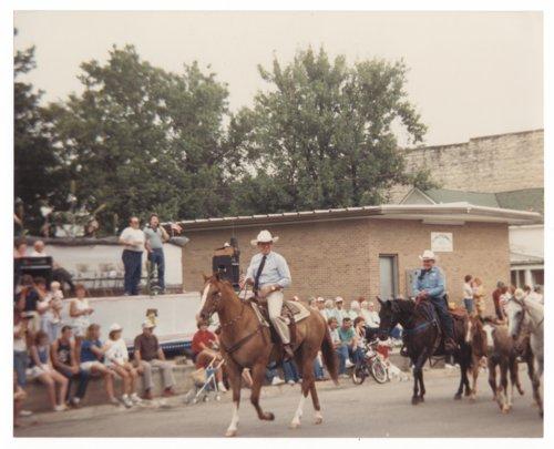 Governor John Carlin riding in a parade - Page
