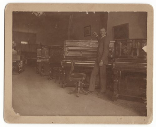 Ernest Ayres tuning a piano in Emporia, Kansas - Page