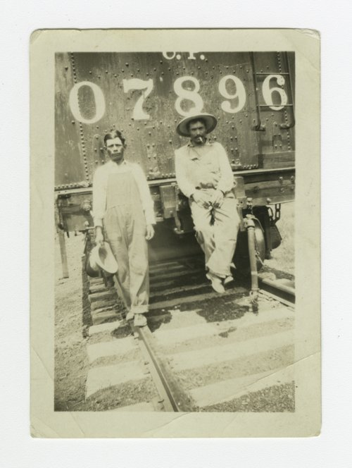 Two Atchison, Topeka & Santa Fe Railway workers possibly in Topeka, Kansas - Page