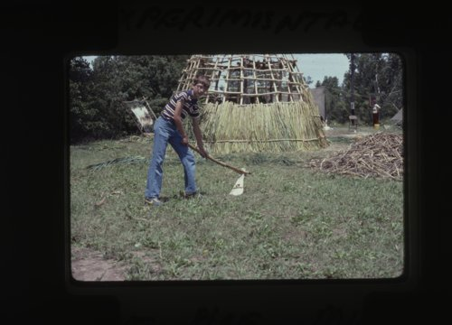 Boy using a scapula hoe photograph - Page