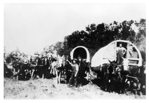 The Catron Family arriving by covered wagon in Topeka, Shawnee County, Kansas, from Greeley, Nebraska