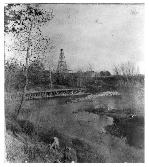Wooden oil derrick beside a dam on the Fall River in Wilson County, Kansas - Page