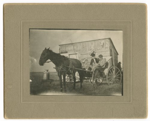 Allena (Mrs. D.E.) Snell and R.G. Snell in buggy on the Snell homestead, Thomas County, Kansas - Page