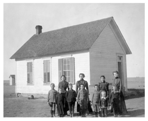 Students pose by an unidentified rural school house, Thomas County, Kansas - Page