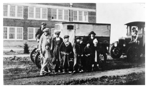 Students pose in front of their school bus, Brewster, Thomas County, Kansas - Page