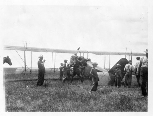 An early airplane sits in a field in Brewster, Thomas County, Kansas - Page