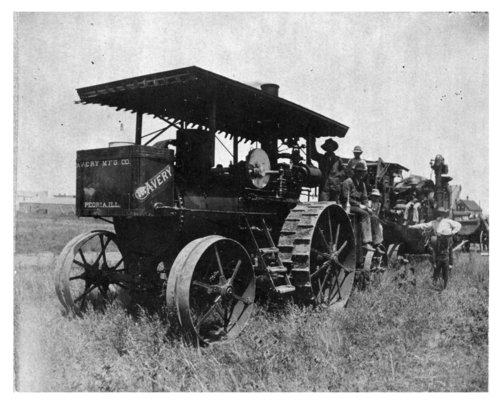 Avery tractor and other wheat harvest equipment in a field in Thomas County, Kansas - Page