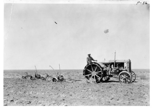Tractor pulling a 6-disc gang plow, Thomas County, Kansas - Page
