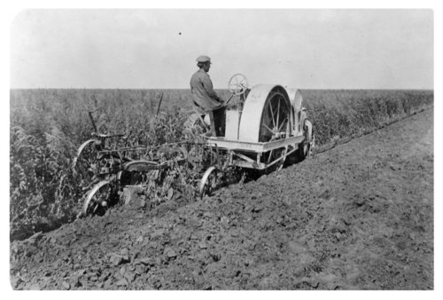 Plowing a field in Thomas County, Kansas - Page