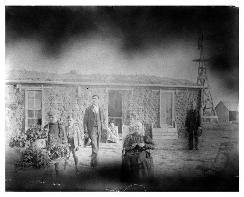 Thomas County, Kansas family outside their sod house. - Page