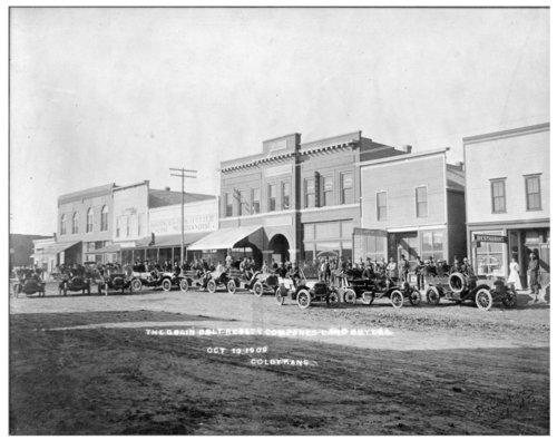 Grain Belt Realty Co. land buyers drive down Main Street, Colby, Thomas County, Kansas - Page