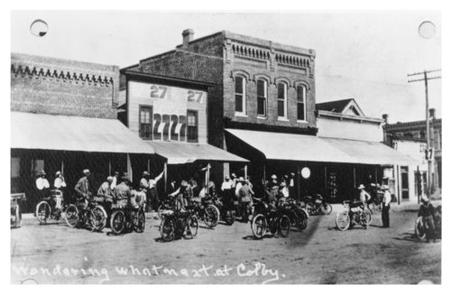 Motorcycle group pose on a street in Colby, Thomas County, Kansas - Page