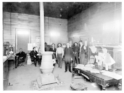 Passengers and employees inside the railroad depot at Neodesha, Wilson County, Kansas - Page