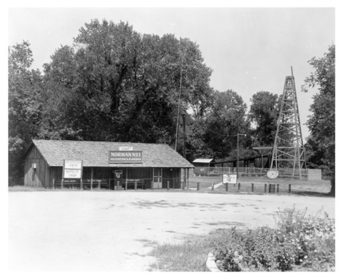 Original site of the Norman No. 1 oil well with museum building and drilling rig, Neodesha, Wilson County, Kansas - Page