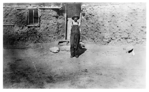 J.W. Terrall stands outside his sod house, Colby, Thomas County, Kansas - Page