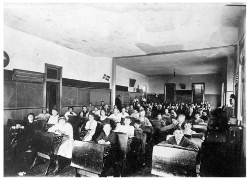 Interior view of an elementary school classroom with students seated at desks, Colby, Thomas County, Kansas - Page