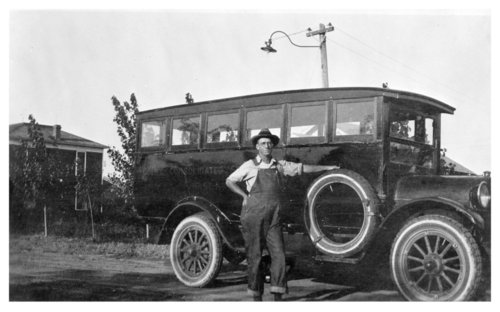 Colby Consolidated School District school bus with unidentified bus driver, Colby, Thomas County, Kansas - Page