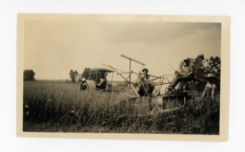 Farm family with tractor and reaper, Butler County, Kansas - Page