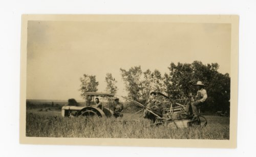 Farm family operating tractor and reaper, Butler County, Kansas - Page