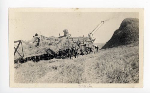 Combine harvesting wheat, Butler County, Kansas - Page