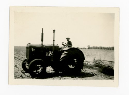 Man driving tractor, discing a field, Butler County, Kansas - Page