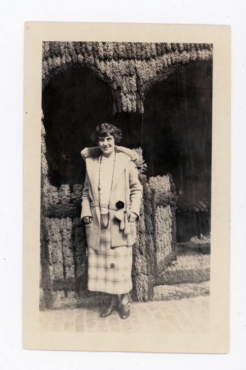 Young woman in front of a booth at the Kaffir Corn Carnival, El Dorado, Kansas - Page