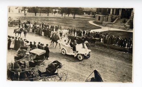 Swan float and buggies at the Kaffir Corn Carnival parade, El Dorado, Butler County, Kansas - Page