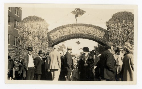 Crowd passing through Kafirville entry arch, Kaffir Corn Carnival, El Dorado, Butler County, Kansas - Page