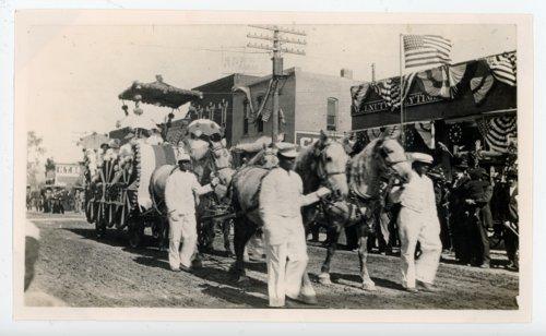 Grooms leading Butler County float, Kaffir Corn Carnival Parade, El Dorado, Butler County, Kansas - Page
