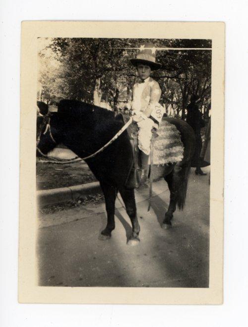 Child Rider in the 1925 Kaffir Corn Carnival Parade, El Dorado, Kansas - Page