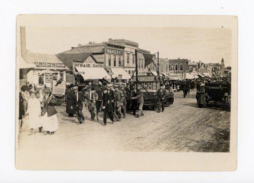 Men Pulling Float in Kaffir Corn Carnival Parade, El Dorado, Kansas - Page