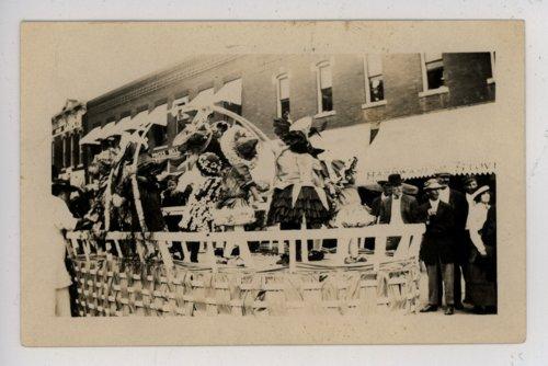 Little girls on flower basket float, Kaffir Corn Carnival parade, El Dorado, Kansas - Page