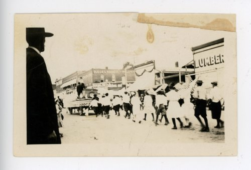 Marchers carry flags, Kaffir Corn Carnival parade, El Dorado, Butler County, Kansas - Page